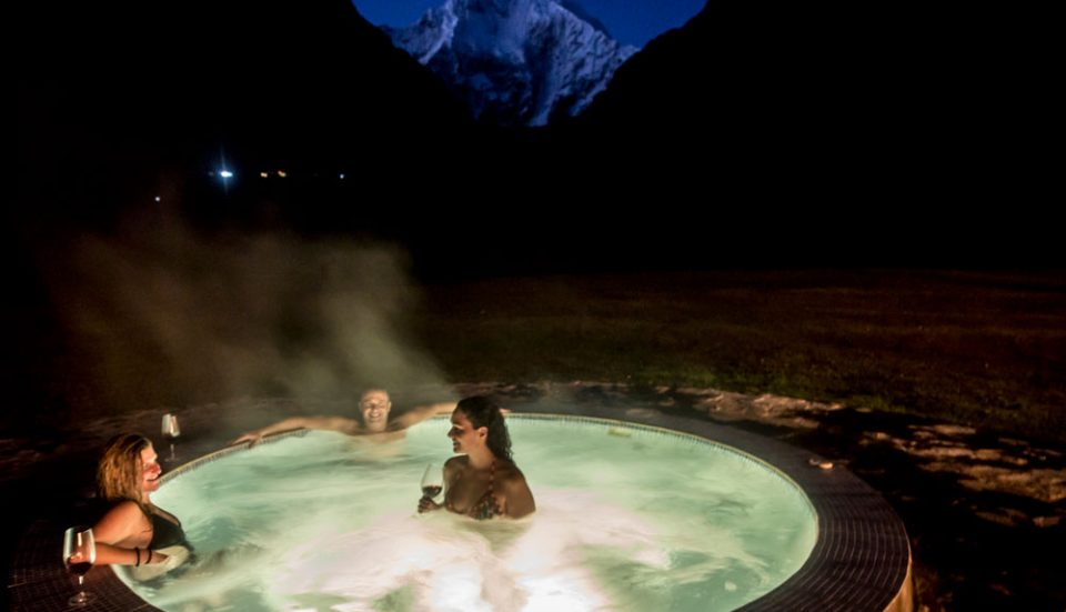 After a rigorous day of trekking--a relaxing sunset soak with a dramatic view of Salkantay Peak